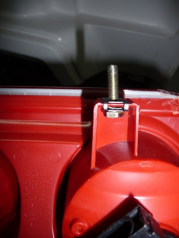 Mounting a bolt in the tab